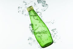 Green Bottle Splashing into the Water Royalty Free Stock Photos