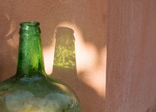 Green bottle translucent shadow Royalty Free Stock Photography
