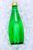 Green bottle of water Stock Images