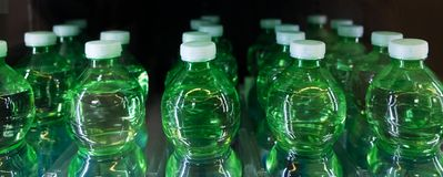 Green bottle water details inside the automatic machine.  royalty free stock photos