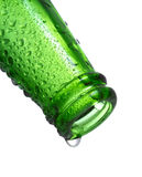 Green bottle with water drops Stock Image
