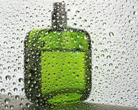 Green bottle and water drops Royalty Free Stock Image