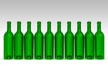 Green bottles. Line of empty green bottles on gray-white background Royalty Free Stock Images