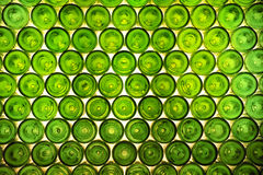 Green bottles background. Patterned background composed by back Stock Photo