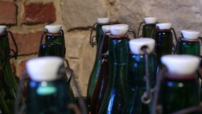 Green bottles with a vintage cap stock footage