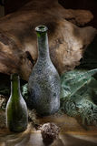 Green Bottles And Wood Royalty Free Stock Images