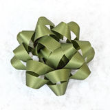 Green Bow. On white snow Stock Images