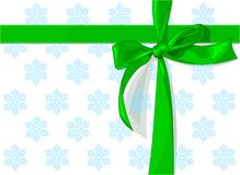 Green_bow. Green holiday bow on snow pattern background Stock Photography
