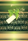 Green bow with card on the decorative background Stock Images