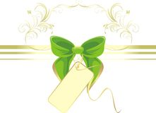 Green bow with card and ornament Stock Image