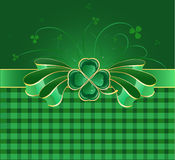 Green bow with clover. Shiny green bow with gilded green decoration in the form of clover with four leaves on a green background with a checkered pattern Vector Illustration