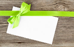 Green bow and empty paper blank Royalty Free Stock Image