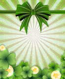 Green bow, gold coins and clover Royalty Free Stock Photography