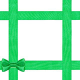 Green bow knot on four satin ribbons isolated Royalty Free Stock Photo