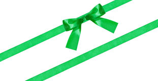 Green bow knot on two diagonal silk bands isolated Royalty Free Stock Photography