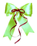 Green bow with red ribbon made from silk Stock Photo