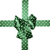 Green bow and ribbon with white polka dots made from silk Royalty Free Stock Image
