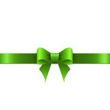 Green bow with ribbons on white background Stock Photo