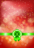 Green bow on a shines red background Royalty Free Stock Images