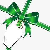 Green bow with tag Royalty Free Stock Image