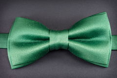 Green bow tie on black Stock Images