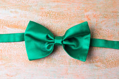 Green bow tie on a table Stock Images
