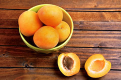 Green bowl with apricots fruit Stock Image