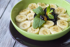Green bowl of cereal with bananas Royalty Free Stock Images