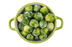 Green bowl with frozen brussels sprouts isolated on white Royalty Free Stock Photography