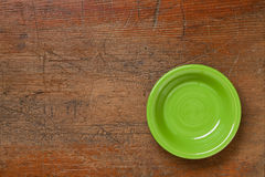 Green bowl on grunge wood. Green ceramic bowl on grunge scratched wood surface Stock Image