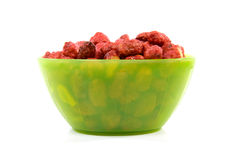 Green bowl with sugared peanuts Royalty Free Stock Images