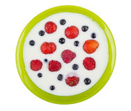 Green bowl with yogurt, blueberries, raspberries, strawberries a Stock Images