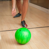 Green bowling ball in the new bowling center. Green bowling ball in the bowling center Stock Photography