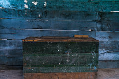 Green box with blue wooden wall stock images