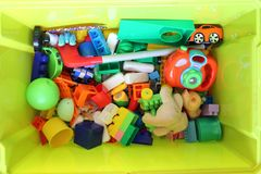 Green box with children`s toys stock images