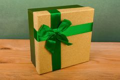 green box for Christmas gifts on a green background, Christmas gifts, green ribbon, green bow Stock Images