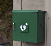 Green box with defibrillator Stock Photos