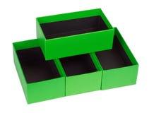 Green boxes wish black velvet Stock Photo