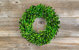Green Boxwood Leaf Wreath on Rustic Wood. Wreath made with real natural green boxwood leaves on rustic wood Stock Photo