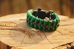 Green bracelet paracord Stock Photo