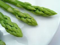 Green braird on a plate--asparagus Royalty Free Stock Image
