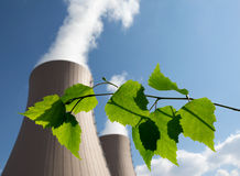 Green branch against nuclear power plant Stock Image