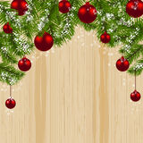 Green branch of fir with red balls and snowflakes on a background of wood. Christmas card. Christmas symbol.. Happy New Year. Vector illustration Royalty Free Stock Image