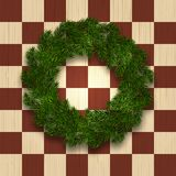 Green branch of spruce in the form of a Christmas wreath with shadow. against the background of a natural tree in a cage. A chess field. Vector illustration Stock Photos