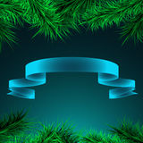 Green branches of spruce and ribbon on a blue background, stock photography