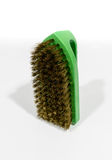 Green brass scrub brush Royalty Free Stock Image