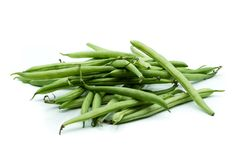 Green breaking beans heap isolated on white background royalty free stock image