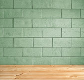 Green brick background and wooden floor Stock Photo