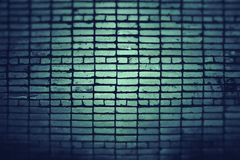 Green brick wall. Green brick wall and a ray of light in the center Royalty Free Stock Photography