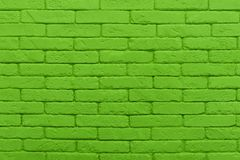 Green brick wall painted at saturated lime colour. texture. Green brick wall painted at saturated lime colour. closeup texture background stock image
